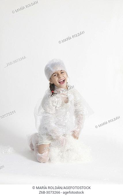 happy little girl wearing bubble wrap