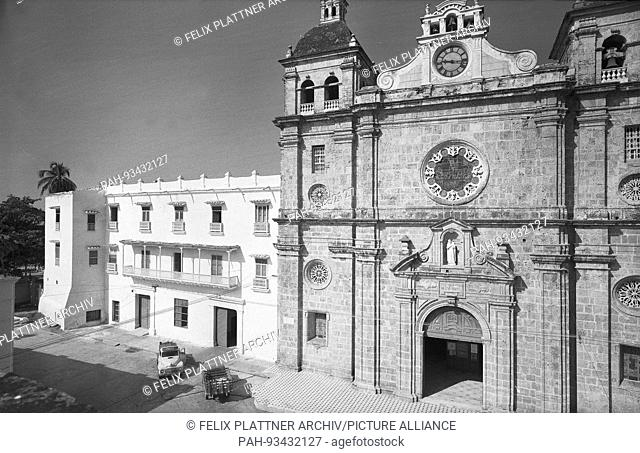 The facade of the church is divided by pilasters and cornices and by two..Low towers, Cartagena (Bolivar), Colombia, 1958. | usage worldwide