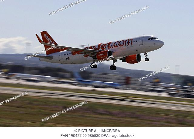 27 April 2019, Spain, Palma: An Easyjet plane is leaving Palma Airport. The number of foreign tourists in Spain again reached a record level last year