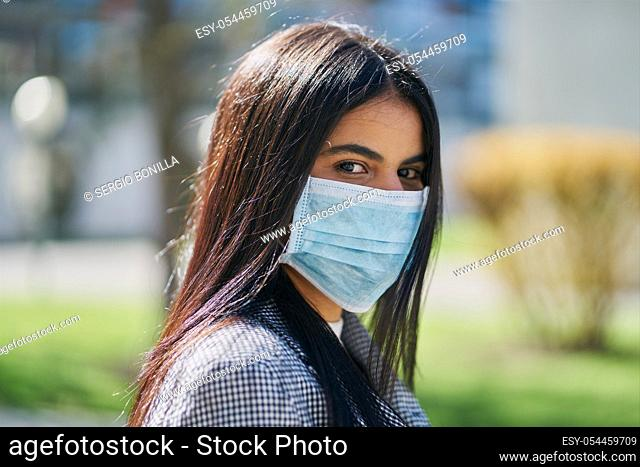Girl with a protective mask to avoid contagion. Coronavirus concept