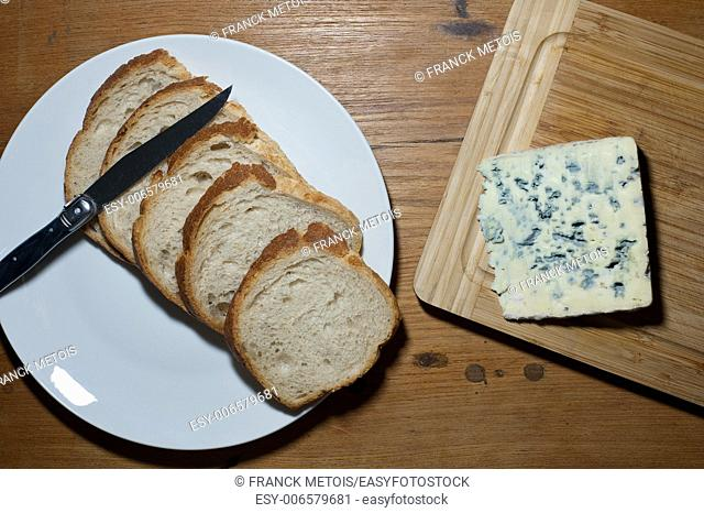 "French cheese called """"bleu d'Auvergne"""" and sliced bread"