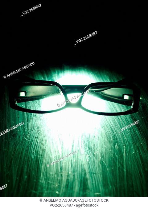 closed glasses over a desk