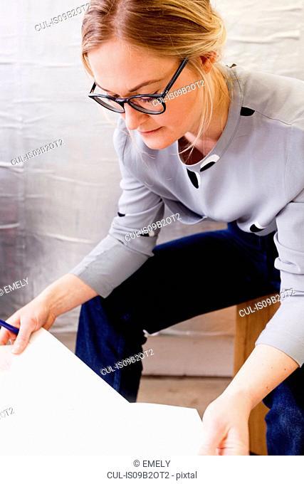 Women sitting looking at paperwork