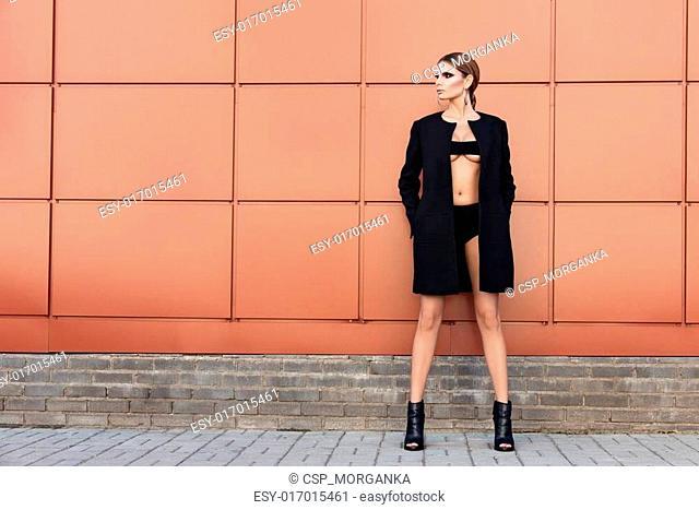 Young fashion woman posing outdoor