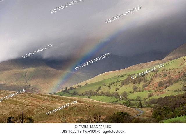 Rainbow in spring showers, over Cautley Crag in the Howgills near Sedbergh, Cumbria, UK. (Photo by: Wayne Hutchinson/Farm Images/UIG)