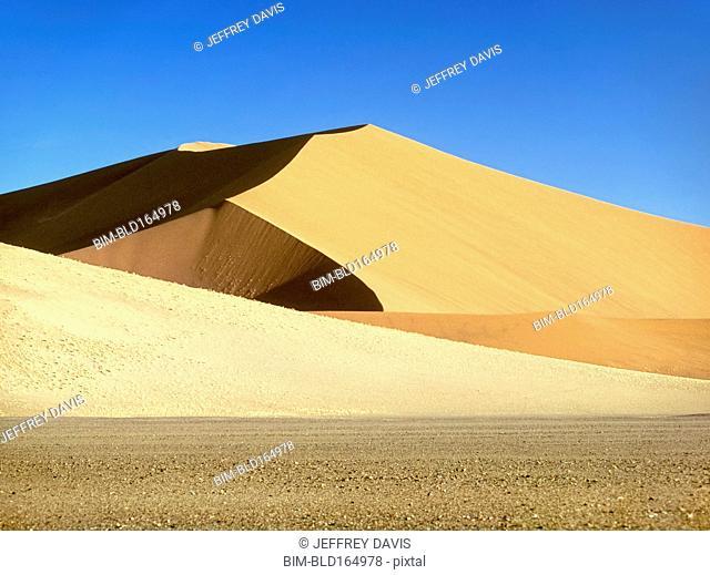 Sand dunes under blue sky in Namib-Naukluft National Park, Namib Desert, Namibia