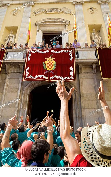 Enxaneta'child who rises to the top of the human tower celebrating a great success in the town hall balcony  Castellers de Sant Pere i Sant Pau 'Castellers' is...