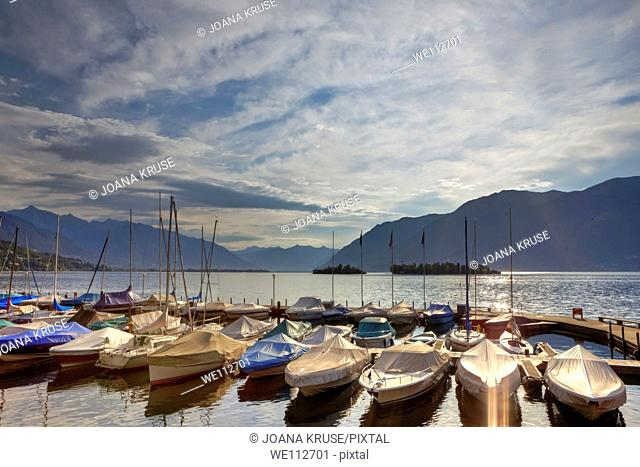 The port of Porto Ronco with morning sun w ith the Brissago Islands in the background