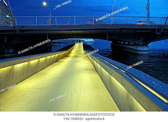 pedestrian passage under Mont Blanc bridge on Rhone river, at night, Geneva, Switzerland
