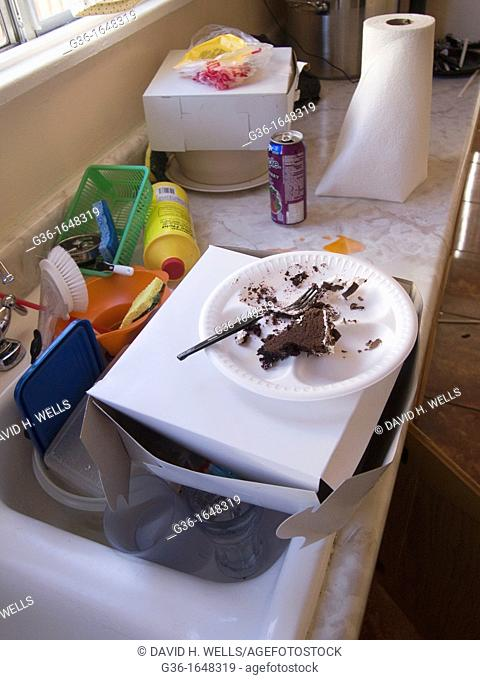 Half-eaten cake in dirty kitchen in a foreclosed house in Huntington Park, California, United States