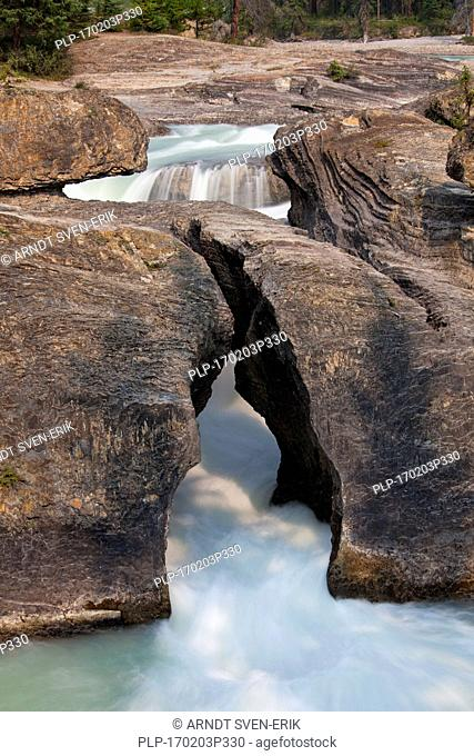 Natural Bridge spans the flow of the Kicking Horse River in the Yoho National Park, British Columbia, Canada