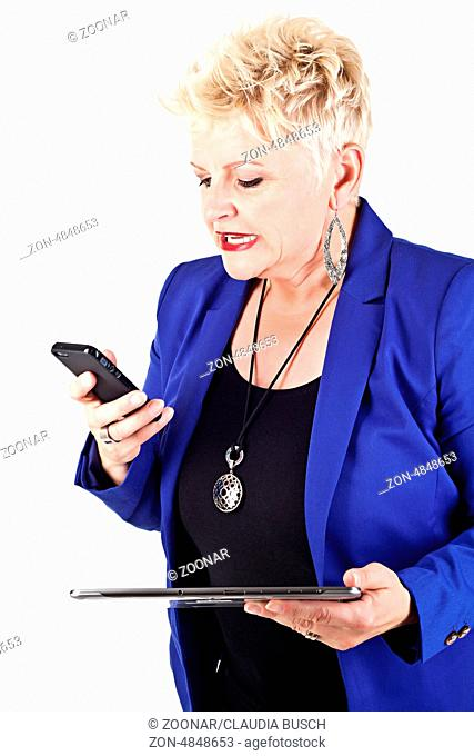 middelaged business woman in jacket talking on the