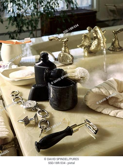 Close-up of grooming products on a sink