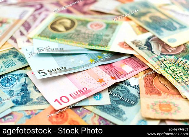 The photo of old Russian ruble banknotes and several euro