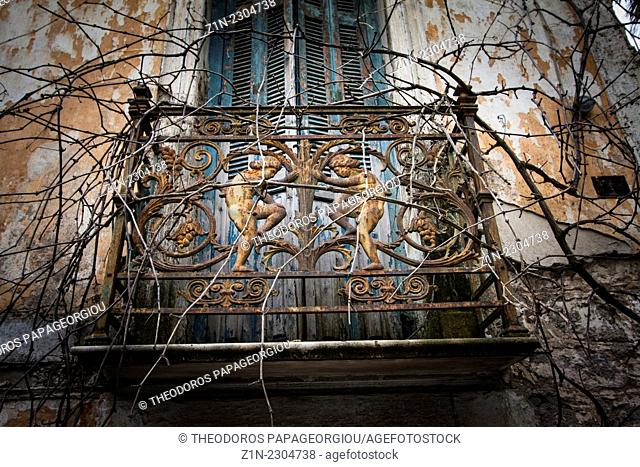 The balcony railing of an abandoned house at Tripoli city. Arcadia, Peloponnese, Greece