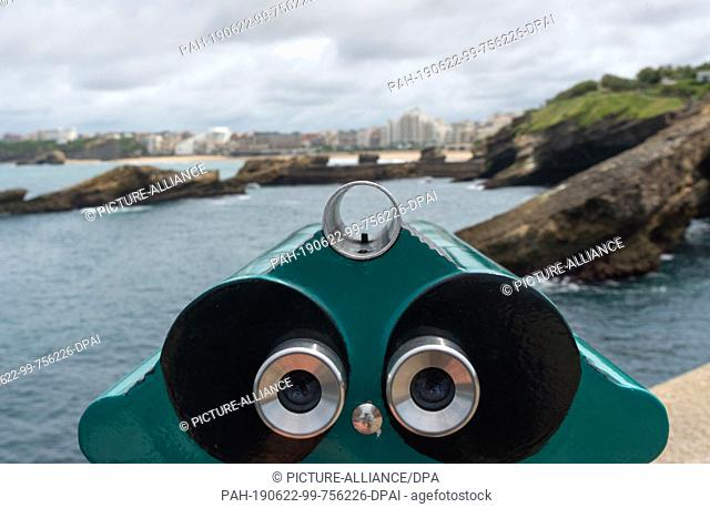 21 June 2019, France (France), Biarritz: A telescope is aimed at the seaside resort of Biarritz. The upcoming G7 summit will take place here from 24