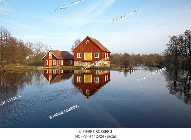 Houses by a dam in Smaland, Sweden