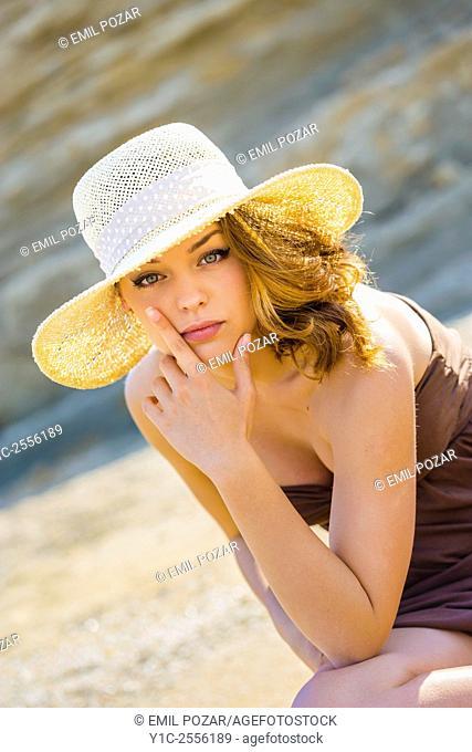 Stock Photo - Teen girl portrait under straw-hat