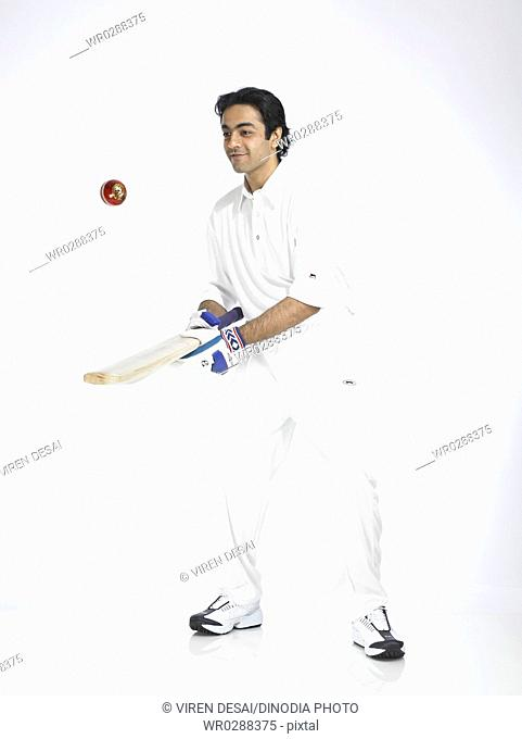 Indian batsman bouncing ball in air with bat MR702A