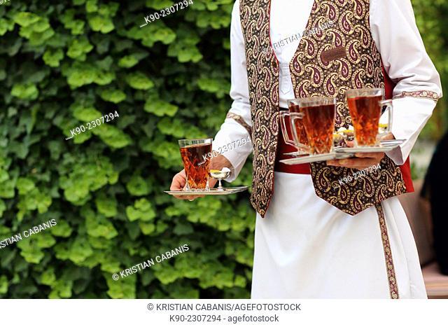 Waiter carrying hot tea, Abbasi Hotel, Esfahan, Iran, Asian