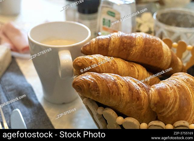 Croissants with coffee cup on breakfast table France