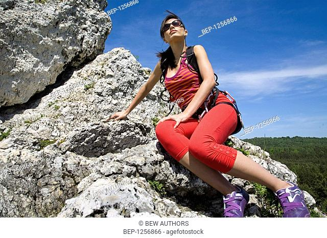 Woman resting on rock
