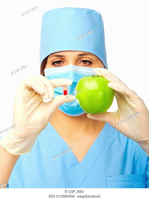 Yougn doctor with pill and apple