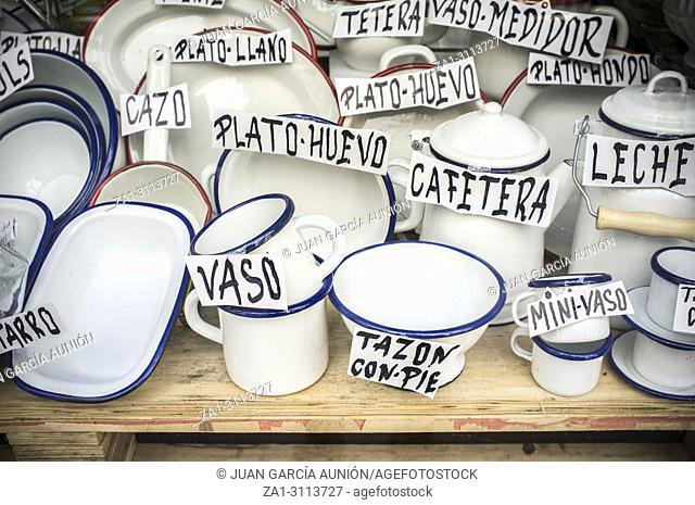 Old spanish shop offering enamel ware. Vintage white ware made from tin material