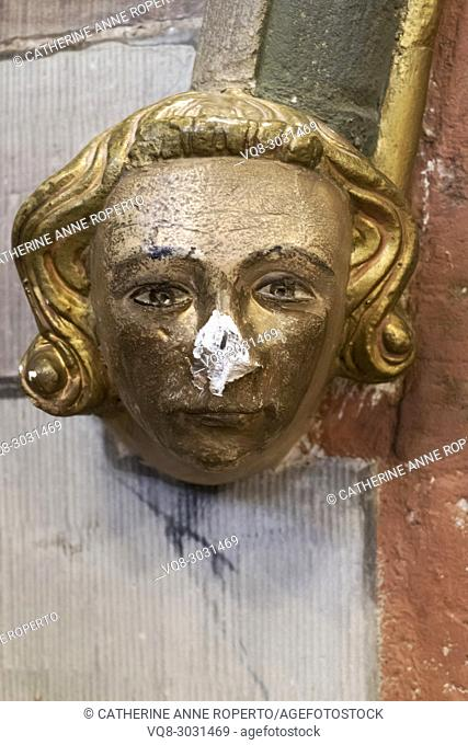 Carved and painted architectural head boss of a young Medieval nobleman with golden hair and a broken nose, Hereford Cathedral, Hereford, England
