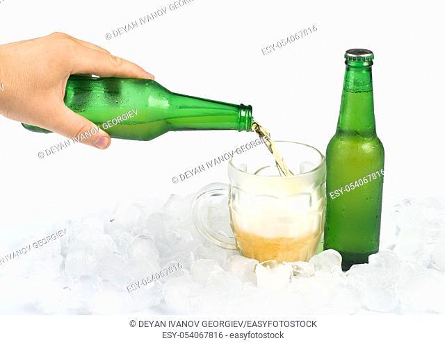 Green bottle of beer and beer mug. White isolated studio shot