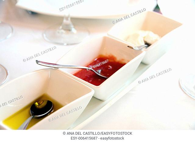Sauces on table olive oil garlic mayonaisse and tomato puree Spain