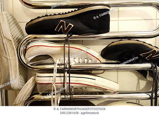 Sneakers drying on hotwater dryer in bathroom. Stockholm, Sweden