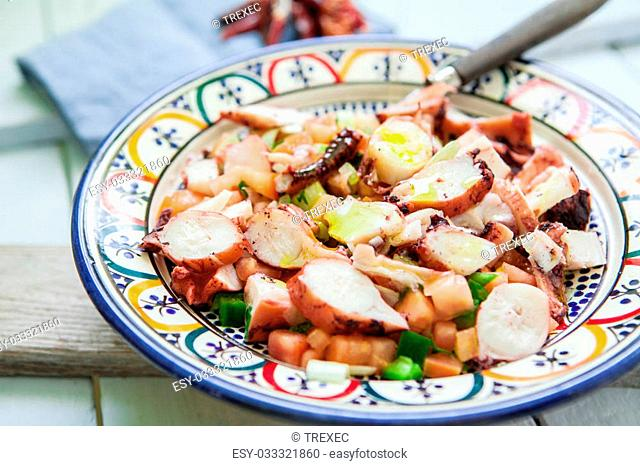 fresh octopus salad with tomato and green pepper