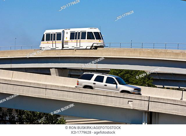 JTA Skyway automated train moves over the Acosta Bridge over the St  Johns River in downtown Jacksonville, FL