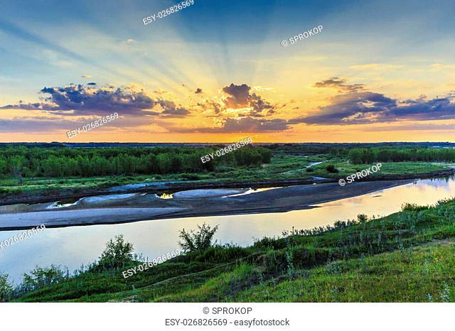 The sun setting over the South Saskatchewan River at Cranberry Flats just South of Saskatoon
