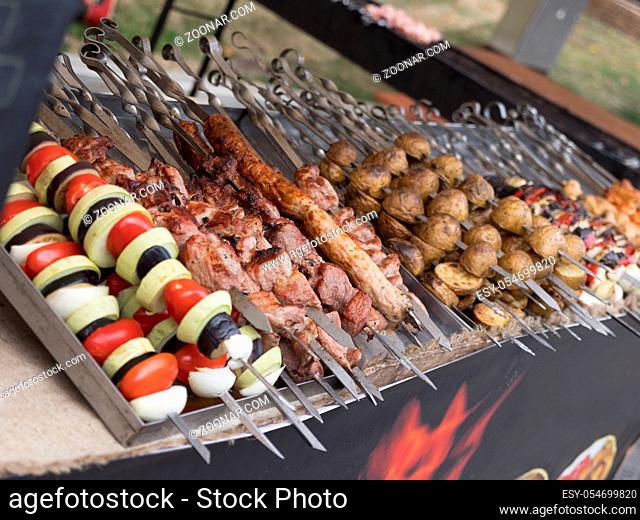 Pork and mutton shashlik on skewers, lulah kebab and lamb ribs served