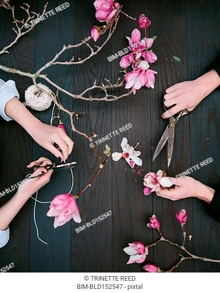 Close up of florists working with flower trimmings