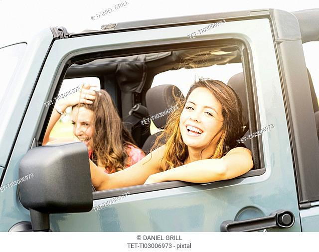 Portrait of female friends (14-15) during road trip