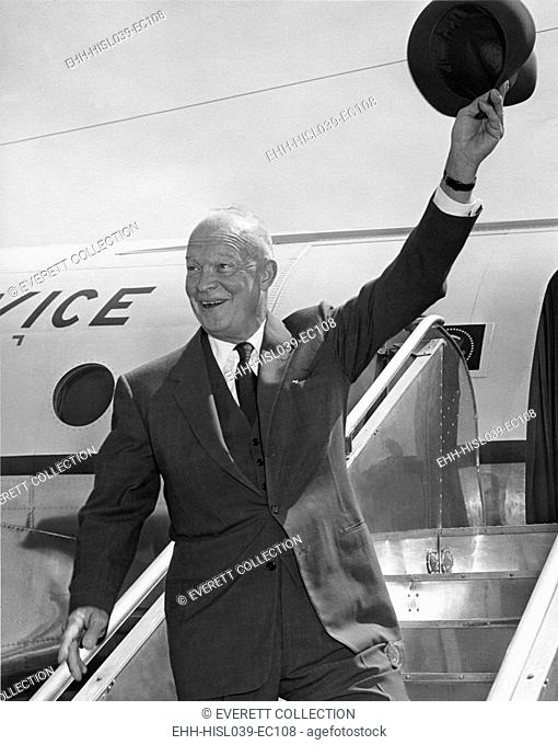 President Eisenhower waving his hat from airplane steps. He was leaving Washington D.C. for a New England trip. June 22, 1955. - (BSLOC-2014-16-58)