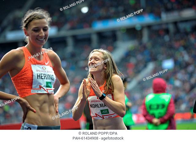 Fabienne Kohlmann (R) and Christina Hering of Germany smile after the women's 800m race during the ISTAF athletics World Challenge in Berlin, Germany
