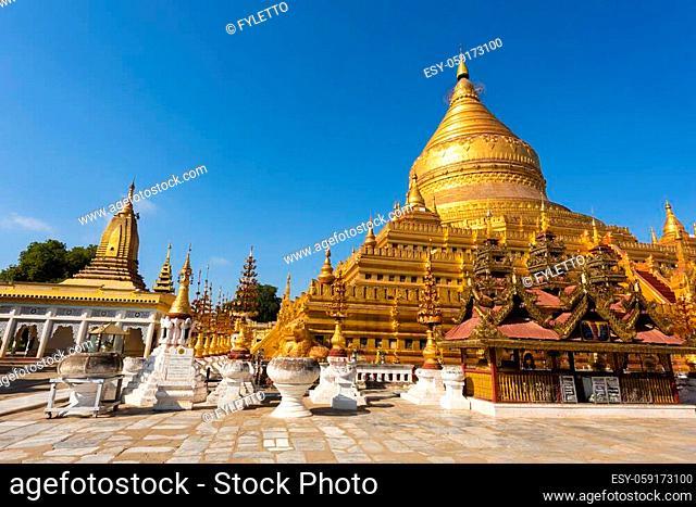 Shwezigon Pagoda is one of the oldest sacred golden buddhist pagoda in Myanmar. Town of Nyaung-U near ruins of Bagan, Myanmar