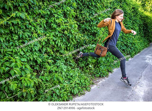 A woman running out from nature