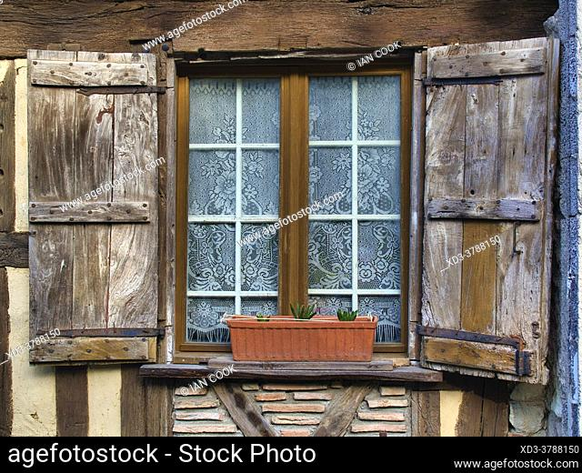 window with old wodden shutters, Cancon, Lot-et-Garonne Department, Nouvelle Aquitaine, France