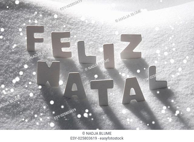 White Letters Building Portuguese Text Feliz Natal Means Merry Christmas On White Snow. Snowy Landscape Or Scenery With Snowflakes
