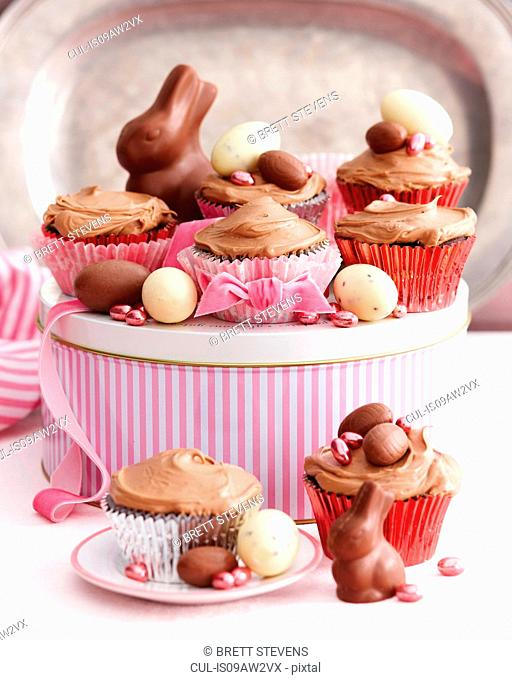 Chocolate cupcakes covered with icing decorated with easter eggs
