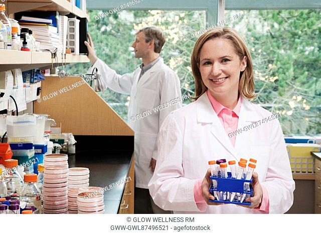 Female doctor holding medical samples in a laboratory