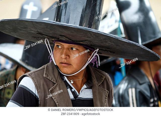 Taking the main square of Cotacachi by Indigenous communities, young man with hat