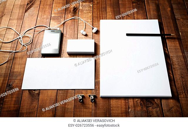 Blank corporate identity template on wood table background. Photo of blank stationery set. Mockup for design presentations and portfolios