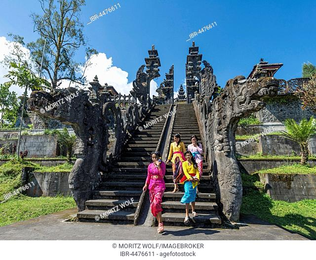 Young Balinese women descend stairs, Mother Temple, Besakih temple, Pura Agung Besakih Penetaran, Bali-Hinduism, Banjar Besakih, Bali, Indonesia