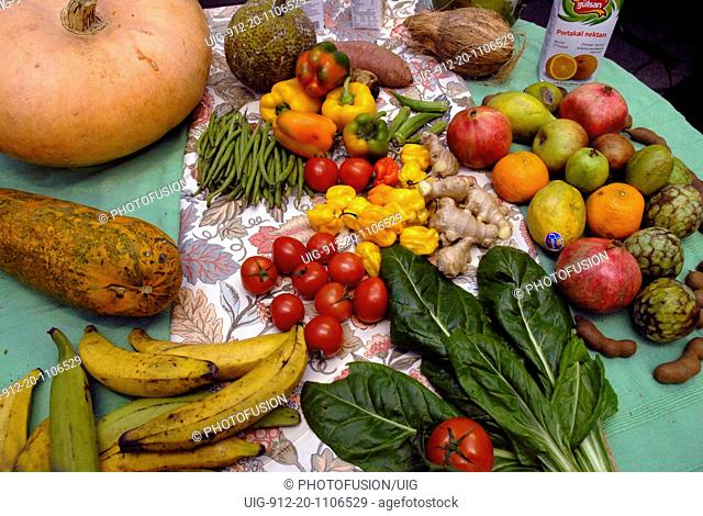 Table display of tropical fruit and vegetables
